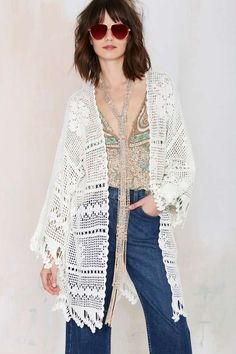 This filet crochet piece (LOVE the trim btw) is really similar to the oversized cardi I just pinned Odette Annable wearing (Somedays Lovin Big Wave Crochet Kimono from Nasty Gal)