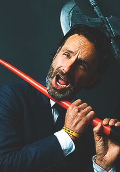 Andrew Lincoln and a light saber!  (He totally just lost 8 of his fingers as well as his head)