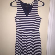 Striped Nautical Dress Very cute dress. It is a V neck but it doesn't plunge. Awesome dress. Worn once. Monteau Dresses