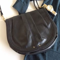 """Half Moon Crossbody Purse Small black handbag in a half moon/saddle bag shape. Strap is adjustable length and detachable on both sides. One inside zipper pocket& one small open pocket. Synthetic, faux leather material. Approx 7.5"""" H x 7"""" W. EUC, no notable flaws. Offers considered. ❌no offsite transactions H&M Bags Crossbody Bags"""