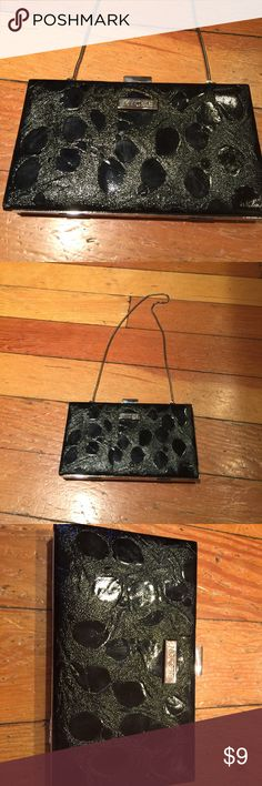 Miche black patent textured hard side clutch. New. Miche black shiny patent clutch. Textured outer that has a leopard-look print. Long silver chain strap has tabs to tuck inside to use as a true clutch. Snap closure. Lots of inner pockets (including zip-closure) and card slots. 7 1/2 x 4 x 1. New without tags. Nonsmoking home. Miche Bags Clutches & Wristlets