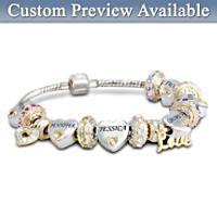 Stainless steel mesh with 13 sterling silver- and 18K gold-plated beads. Add up to 6 engraved names and Swarovski crystal birthstones. Gift box.