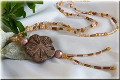 Fine beaded necklace with stone flower