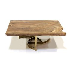 "The ""Swirl"" Coffee Table pairs a vintage brass base with a beautiful Bastogne Walnut slab. The grain and figure of the wood is exceptional, with colors ranging from blacks to browns and even oranges.  The clean lines and double-beveled edge are te..."