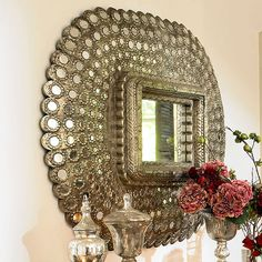 a lovely mirror with an antique-y eastern vibe.