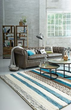Dutch living room with woolen carpet and chester sofa by #Eijerkamp