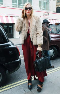 WHO: Joanna HillmanThe now fashion director at Harper's Bazaar layered a furry cropped coat over her crimson maxi.Keep going to shop standout pieces inspired by street style! Street Style Looks, Street Style Women, Fashion Editor, Autumn Winter Fashion, Winter Style, Dress Codes, Get Dressed, Everyday Fashion, Style Guides