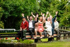 A wedding with a Joust! Bride and groom with guests all aboard the miniature train at Avoncroft Museum of Historic Buildings (avoncroft.org.uk). Rob & Sarah Gillespie Photographers.