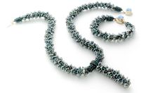 Create a necklace or bracelet of cascading blossoms using Flowercup beads and seed beads in a kumihimo braid.