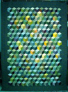 According to the quilter, the actual color of this quilt is autumn colors. The colors has been changed using image processing software. Quite lovely in green!
