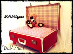 """""""Dash's Nest""""  Is a little something we did as a gift for a friend and her best friend Dash. Vintage suitcase repurposed into a pet bed complete with plush pink cushion and dainty pink legs."""