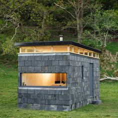 """Eight pop-up """"glamping"""" cabins built to tour the Welsh countryside Slate Cabin by Trias studio Green Architecture, Sustainable Architecture, Off Grid Cabin, Stone Facade, Tiny House Cabin, Little Houses, Tiny Houses, Cabins In The Woods, Green Building"""