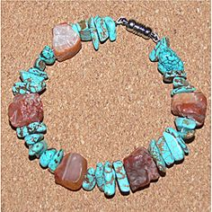 @Overstock - This stylish bracelet features orange carnelian nuggets and gold flecked turquoise nuggets. This bracelet features a silver-plated magnet closure that is easy on and off.http://www.overstock.com/Main-Street-Revolution/Susen-Foster-Carnelian-and-Turquoise-Chickasaw-Memory-Bracelet/6327432/product.html?CID=214117 $27.49