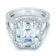 Beauty at its finest...Amazign design.....Custom Diamond Halo Engagement Ring