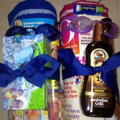 Made this for my inlaws 41th anniversary they are taking a vacation cruising the east coast. Along the way the way they are stopping at beaches. So i saw this idea on here and had to try it. Beach towels, arm floaties rolled up inside the towels, magazines for him and her. His is the gossip magazine. Lol sun tan lotion, water proof camera, chap stick, googles.