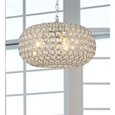 Dazzling crystals catch the light and create a richly elegant ambiance in any room. This stunning chandelier encases three 60-watt bulbs, finished with a chrome base made of iron. - Entryway
