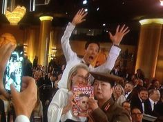 Who was looking kind of like a cater waiter. | The 22 Most Important Things That Happened At The Golden Globes