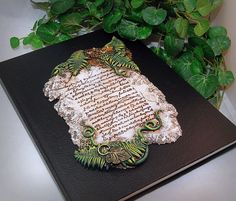 Ooak Polymer Clay Ancient Stone Tablet Blank Sketchbook/Journal Art Journal Diary Writing supplies   This awesome Stone Tablet Ooak (one of a kind) blank journal is unique and perfect for the artist, writer,or anyone who loves to keep a journal! Who wouldnt want to curl up with a hot cup of coffee or tea, and sit to write or draw in this journal? Hand made from polymer clay. What a totally unique and wonderfully special gift this would make for anyone!  *** Please Note: Full disclosure…