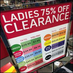 Color-Coded Clearance Sale Sign in Apparel
