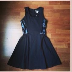 Little black dress Super cute skater style dress with faux leather sides. In great used condition. Used twice. Exposed zipper. No PayPal no trades. Last picture is a similar dress to show look. Necessary Objects Dresses