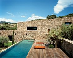 Poolside at another Studio KO–designed home in the south of Corsica