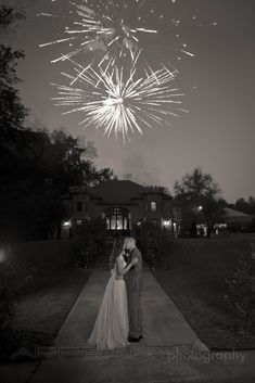 Bride and groom watching fireworks on wedding day at the Sterlin