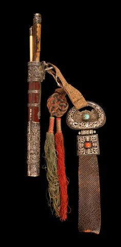 China - Xizang Autonomous Region (Tibet). | Belt belt ornament, with the container holding a pair of chopsticks and a knife.  Silver toned metal, leather, coral, turquoise, wood, bone and silk thread // ©Quai Branly Museum. 71.1994.34.2.1-6