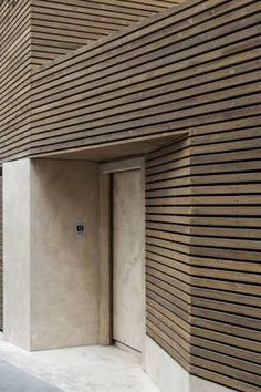 Bagh-Janat residential architecture with timber and travertine cladding in Isfahan Iran by Bracket Design Studio Wooden Cladding, Wooden Facade, Timber Slats, Brick Facade, Wooden Slats, Wall Cladding, Design Studio, Architecture Résidentielle, Cladding Materials