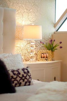 Bedroom: Teen Bedroom Highlights Beautiful Gold Patterned Accent Wall. teenage bedroom ideas. floral pattern wallpaper. tufted headboard. glass lamp base. white nightstand. metallic photo frame. metallic flower vase.