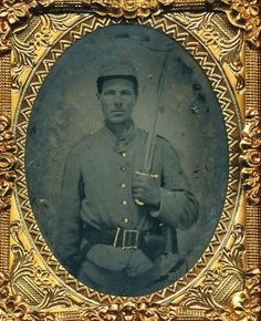 Armed Confederate 1/9 plate tintype of a private wearing an 1855 rifleman's…