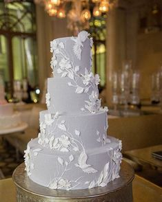 Dove gray and white wedding cake with leaves and bird design