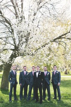 Groomsmen with purple ties(instead of pink) and different shades.