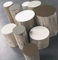 Log seats for around fire pit. Like that they have tops you could wipe down and won't splinter your bum!