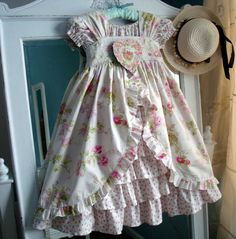 pinafore ( with opeining in the front) over a ruffled peasant dress. adorable!