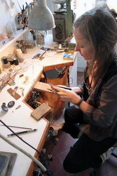 Judy McCaig at workbench
