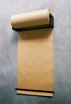 scratch craft paper at the ready? yes, please. A Little Bit OCD: Ikea Hack // Kraft Paper Dispenser for under $15