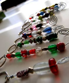 This would be great to do with the kids at the Teen Center Hobby Lobby has tubs of glass beads, spools of wire and key chain rings...all you would need would be needle nose pliers and wire snips....