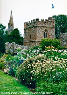 The gardens at Broughton Castle, Broughton, two miles south-west of Banbury, Oxfordshire.  It was built as a manor house by Sir John de Broughton in 1300 at a location where the confluence of three streams created a natural site for a moated manor.