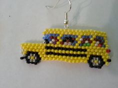 Hand beaded School bus earrings, 1 has kids and the other doesn't.  find them on www.etsy.com/shop/letrishacreations