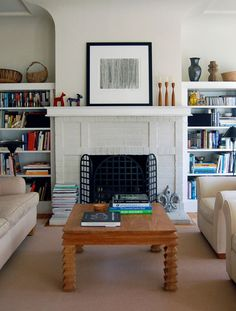 Our living room has a similar built-in shelves around fireplace set-up... when our current sectional goes to sofa heaven, I'd love a furniture alignment like this.
