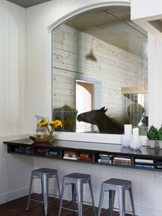 The living room of this converted barn features a large window that looks into the horse stables. WOW, you really have to love horses! Dream Stables, Dream Barn, Horse Stables, My Dream Home, House With Stables, Equestrian Stables, Tallit, Great Rooms, Sweet Home
