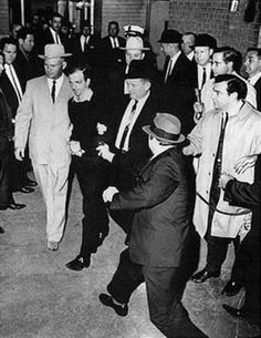 Lee Harvey Oswald being shot by Jack Ruby as Oswald is being moved by police, 1963 - Lee Harvey Oswald - Wikipedia, the free encyclopedia