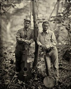 """Matthew Kinman and Moses Nelligan, Clifftop, WV"" is one of the photos by Lisa Elmaleh featured in the ""American Folk"" exhibit at Candela Gallery. Kinman (Roan Mountain Hilltoppers) and Nelligan are modern practitioners of old-timey folk music. Vintage Photographs, Vintage Photos, Cabins In West Virginia, American Folk Music, Best Guitar Players, Lisa, History Of Photography, Guitar Photography, Portrait Photography"