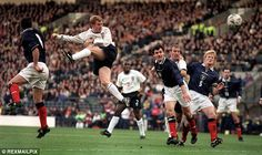 Paul Scholes (second left) heads in his second goal for England against Scotland at Hampden Park in 1999