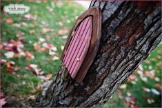 """I just adore this """"Fairy Door"""" on the tree. I really want to find one of these."""