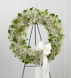 Babys breath and ivy sympathy wreath for Canadian funeral or sympathy flowers, available at www.flowersforcanada.com