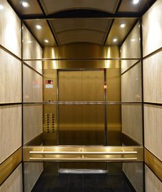 Brass trims, support bands, and a suspended ceiling makes this elevator interior a jewel in the heart of a historic Montréal building.