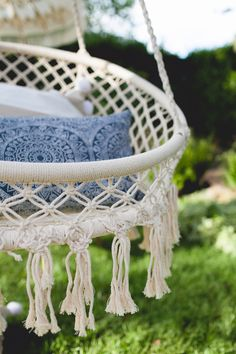 a macrame chair makes for the perfect backyard perch | via coco kelley
