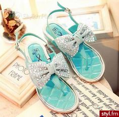 Cute turquoise sandals with bows
