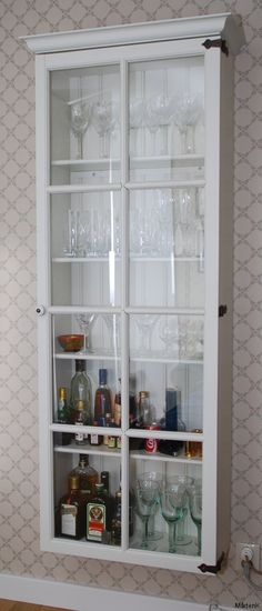 I really like this idea as a mini bar, or china cabinet.